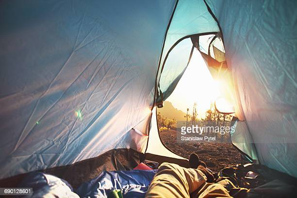 View from tent at sunrise in mountains