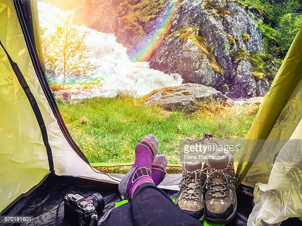 View from tent of waterfall with rainbow