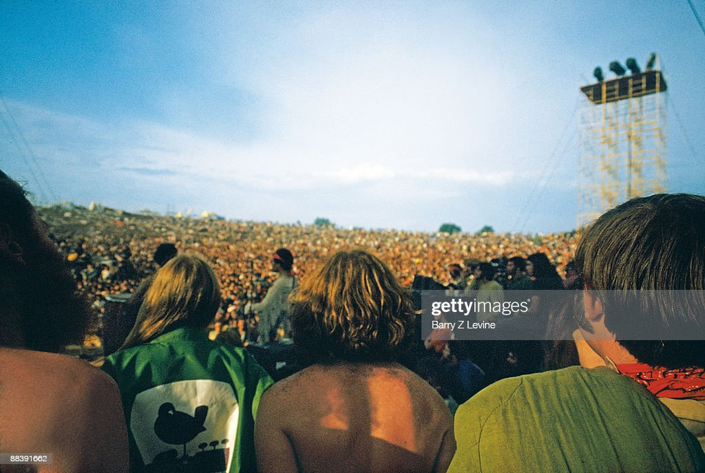 View from the back of the stage of American musician Jimi Hendrix performs with his band Gypsy Sun And Rainbows at the Woodstock Music and Arts Fair...