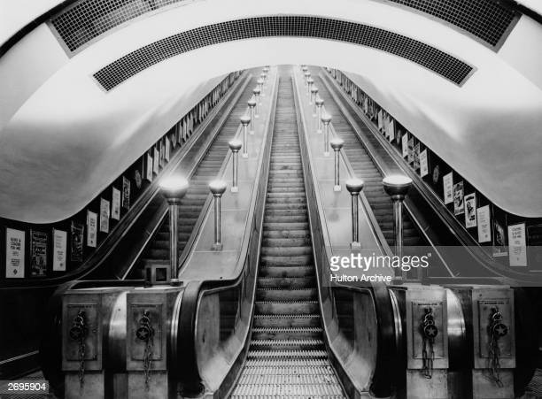 View from the bottom of the escalators at Leicester Square tube station on the Northern and Piccadilly lines London England The escalators have a...