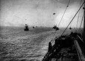 View from the bridge of an oil tanker during the last lap of its voyage home from the United States in a convoy and showing barrage balloons flying...
