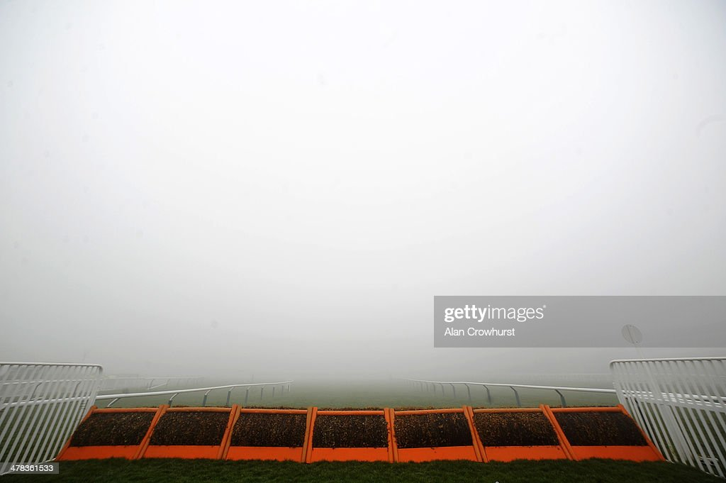 A view from the final hurdle on a foggy morning on St Patrick's Thursday during the Cheltenham Festival at Cheltenham racecourse on March 13, 2014 in Cheltenham, England.
