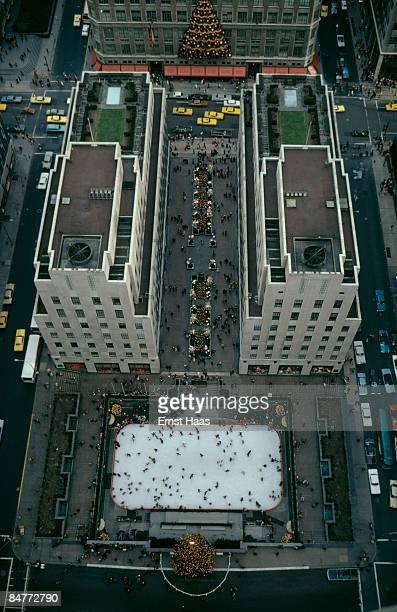 A view from the GE Building of skaters on the ice rink in Rockefeller Plaza Manhattan New York City December 1971