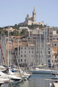 View from the harbour Vieux Port on the cathedral NotreDamedelaGarde in Marseilles the European Capital of Culture 2013 on June 23 2013 in Marseilles...