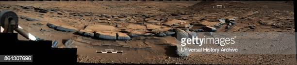 View from the Mastcam on NASA's Curiosity Mars rover looks southward at the Kimberley waypoint In the foreground multiple sandstone beds show...