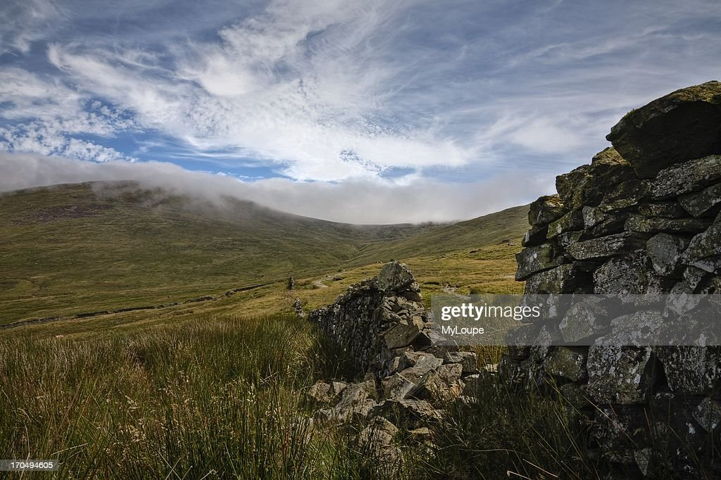 View from the Ott Track with clouds covering the top of Slieve Loughshannagh Mourne Mountains County Down Northern Ireland United Kingdom
