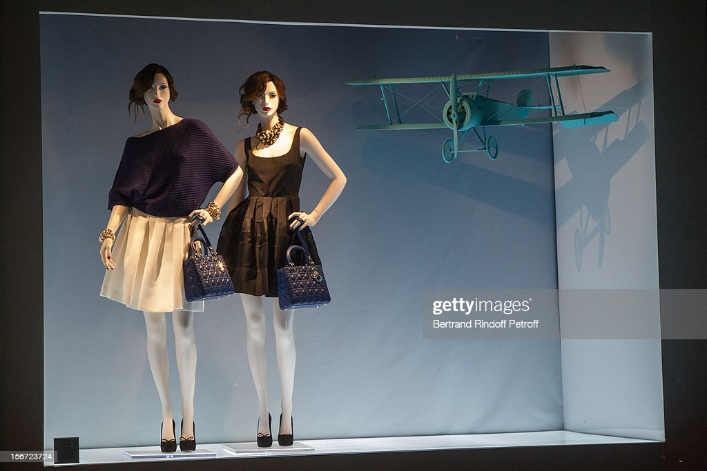 A view from the outside of Dior Boutique's window, during the signing of actor Francis Huster's book 'And Dior Created Woman' at Dior Boutique on November 19, 2012 in Paris, France.