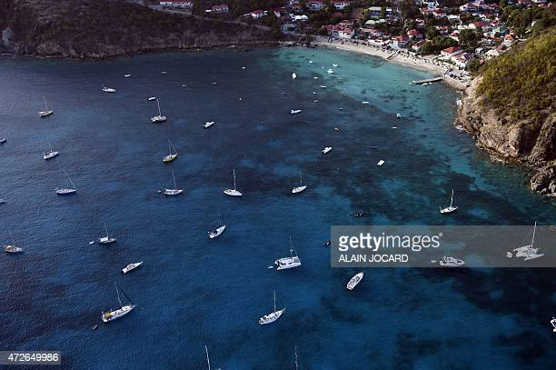 A view from the plane of boats at Saint Barthelemy island on May 8 2015 AFP PHOTO/ ALAIN JOCARD