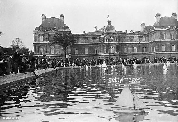 View from the pool of the Luxembourg Gardens on which float small sailboats with which children play in front of the Senate on January 20 1938