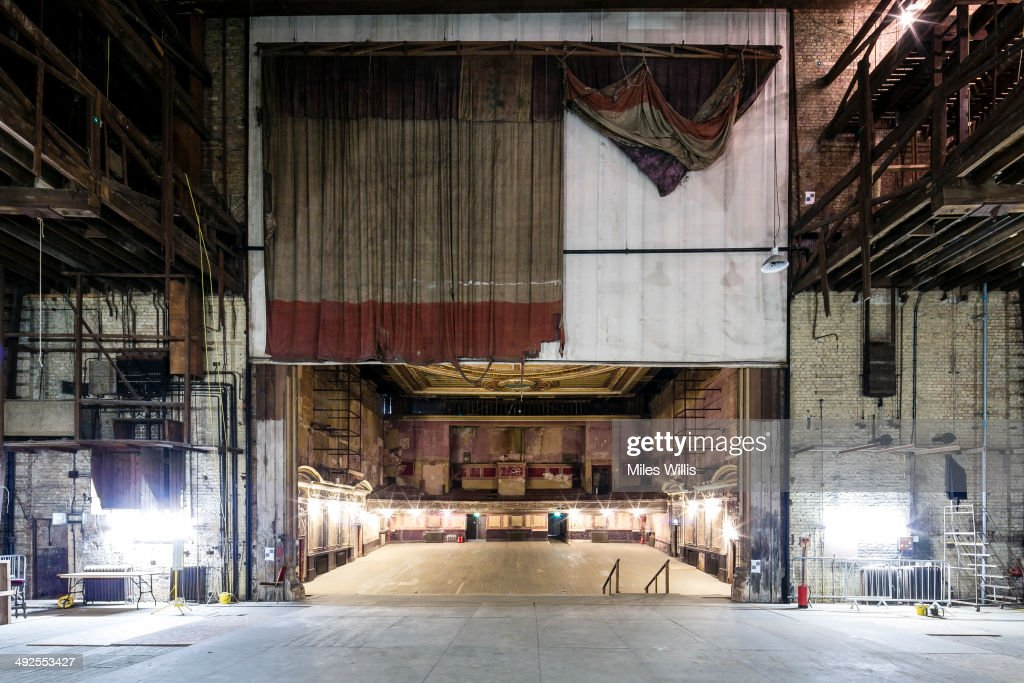 A view from the stage looking out including the original stage curtain at Alexandra Palace Theatre on May 16, 2014 in London, England. Alexandra Palace situated in the London Borough of Haringey First opened as 'The People's Palace' in 1873. Just 16 days later a fire broke out in the Palace, burning it down in its entirety. On 2 November the world's first regular high-definition public television broadcast took place from the BBC studios at Alexandra Palace. In 1980 fire again burned a large part of the building, the Palace reopened in 1988. Recently awarded a Round 1 pass from The Heritage Lottery Fund the Palace plans to renovate parts of the derelict building including the BBC Studios and Victorian Theatre.
