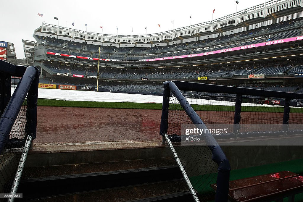 A view from the third base dugout of the covered field during a rain delay before the game between the New York Yankees and Washington Nationals on...