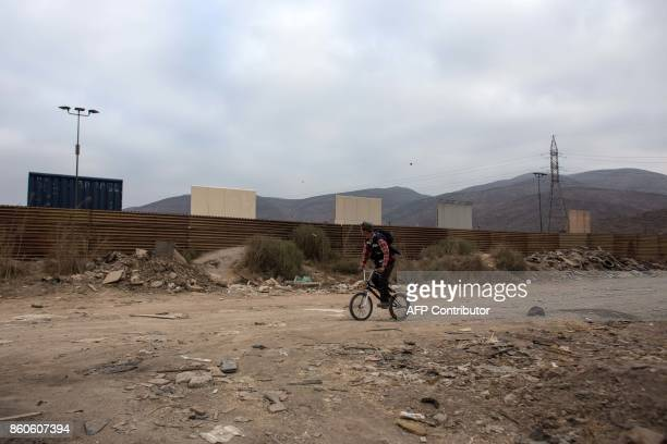 TOPSHOT View from the Tijuana side Mexico on October 12 2017 of prototypes of US President Donald Trump's USMexico border wall being built near San...