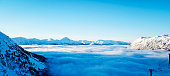 Picture taken at the top of Alyeska Ski Resort, in Alaska.  At this height on the mountain the skies were clear, cold, and very sunny.  Looking out over the valley a layer of fog had settled in.  The