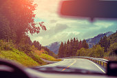 View from windscreen. Driving a car on mountain road. Nature Norway