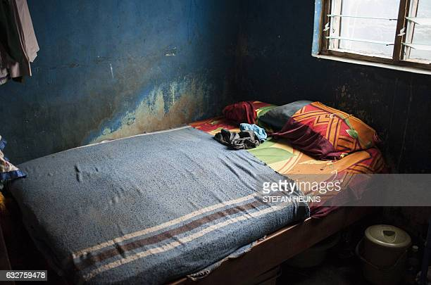 A view inside a room shared by a family of seven on January 6 2017 in Lagos Nearly two years after taking office Nigeria's President Muhammadu Buhari...