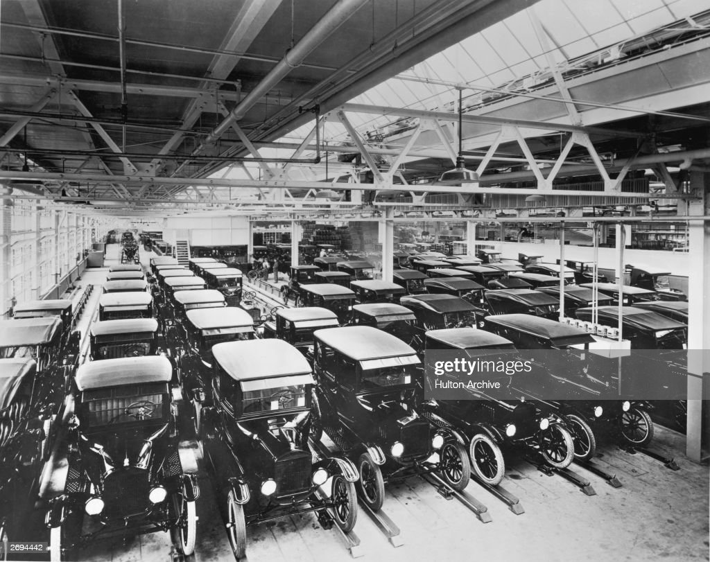 A view inside the Ford Motor Company factory with rows of new Model T motor cars & Model T Ford Stock Photos and Pictures   Getty Images markmcfarlin.com