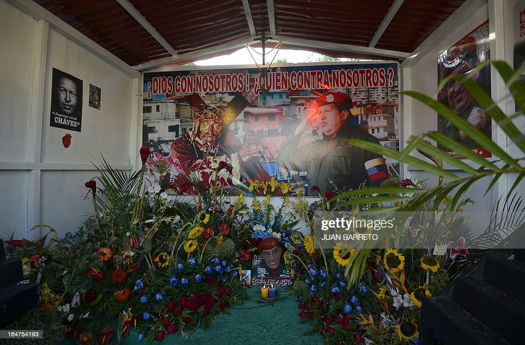 View inside the newly inaugurated Santo Hugo Chavez del 23 chapel, at the 23 de Enero neighbourhood, in the surroundings of the museum where the remains of President Chavez lay, in Caracas on March 27, 2013. Poster reads: 'God with us! Who against us?'.