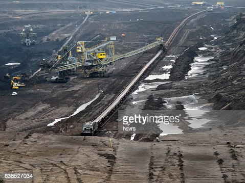view into coal mine with machines and conveyor belt