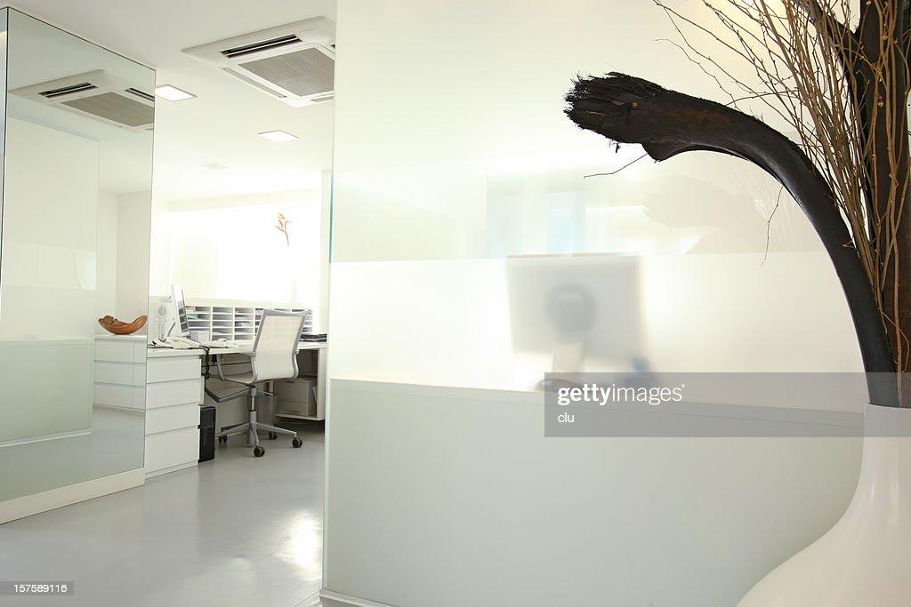 view into modern reception desk white grey mood stock photo