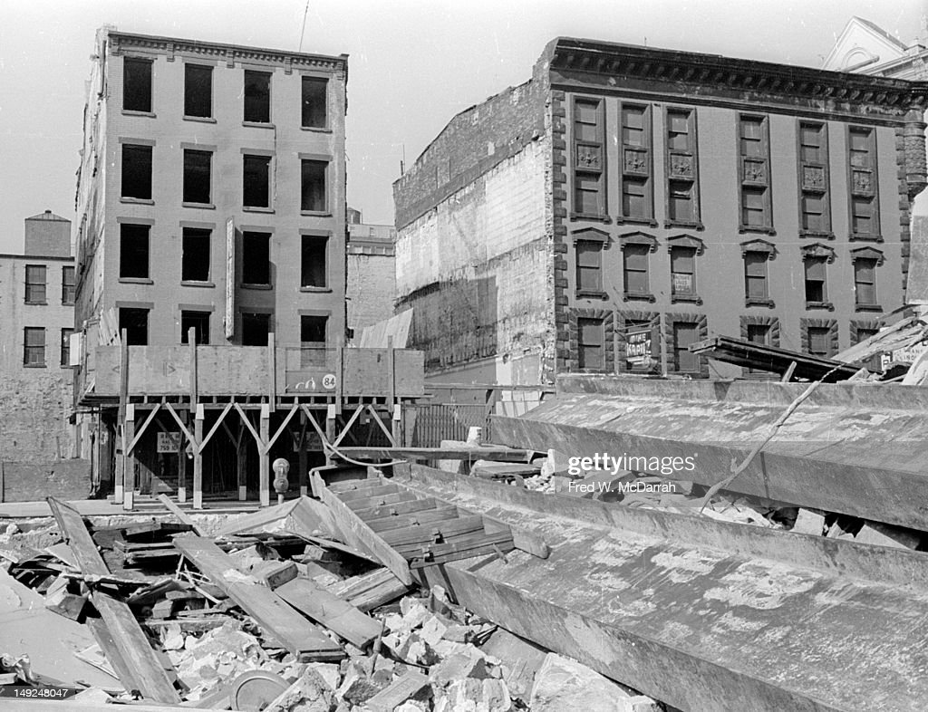 View looking across rubble at the north side of Cordland Street, formerly home to 'Radio Row,' as seen during the demolotion phase of the groundlaying for the World Trade Center, New York, New York, May 29, 1966. The building at the left is 84 Cortandt, former home of the Rand Radio Corp. and the one on the right is 80-76 Cortland, former home of Mike Kranz (#80), Short Wave Radio (#78), and North Radio (#76).