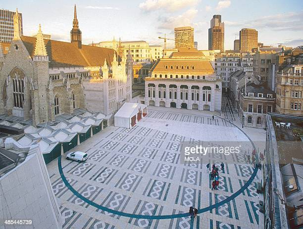 View looking east towards the new Guildhall Art Gallery with the line of London's Roman amphitheatre's arena wall marked out in slate set into the...