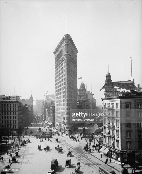 View looking south upon the Flatiron Building located at 175 Fifth Avenue showing pedestrian and vehicular traffic at the intersection of Broadway...