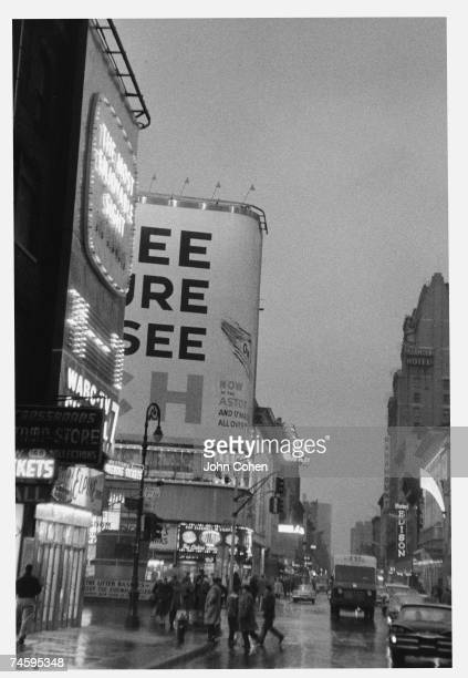 View looking west along West 46th Street at 7th Avenue on a rainy day New York New York 1962 Visible buisnesses include the Hotel Edison and the...