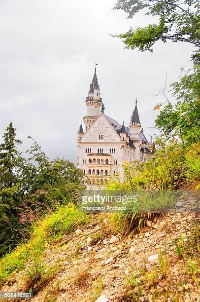 CONTENT] View Neuschwanstein Castle near Füssen town and village of Schwangau Bavaria Germany