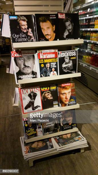 A view of 12 different front pages of French magazines after singer Johnny Hallyday's death on December 11 2017 in Paris France Johnny Hallyday died...