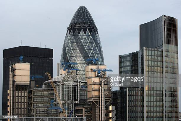 A view of 30 St Mary Axe also known as 'The Gherkin' and Lloyd's Building in the foreground viewed from the top of The Monument the world's tallest...