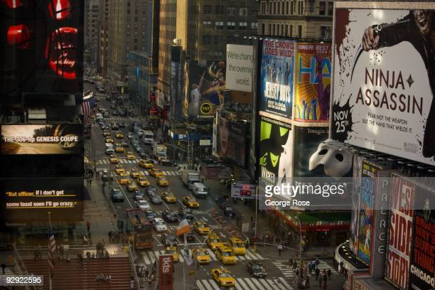 A view of 7th Ave and the large Times Square billboards is seen in this 2009 New York NY early evening cityscape photo