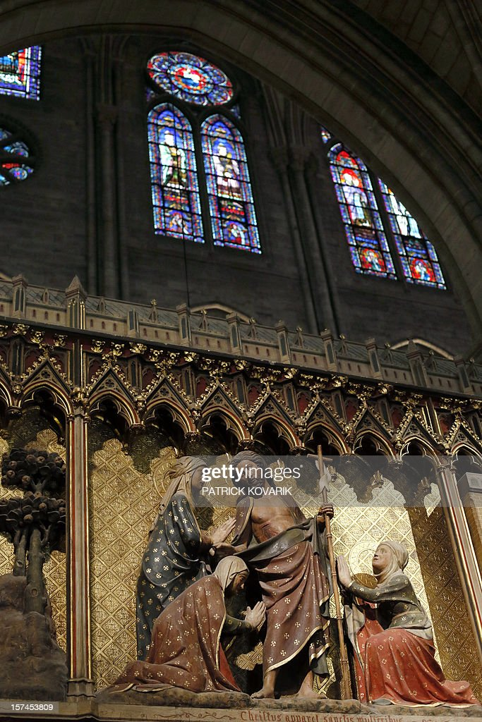A view of a 14th century wood sculpture depicting scenes from the life of Christ, inside the Notre-Dame de Paris cathedral, on November 29, 2012, in Paris.
