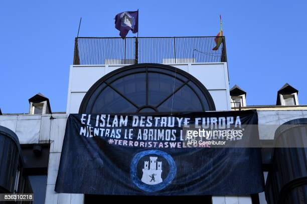 View of a banner reading 'Islam destroys Europe while we open the doors' deployed by the far right group 'Hogar Social' in Madrid on August 21 four...