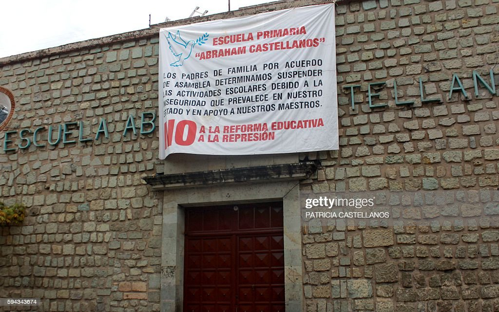 View of a banner reading 'No to the educational reform no to repression' over the closed door of a school in Oaxaca Mexico on August 22 during a...