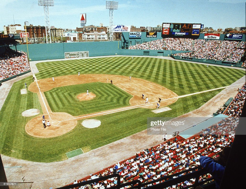 View of a baseball game between the Boston Red Sox and the Toronto Blue Jays and of the Green Monster leftfield wall from the upper deck at Fenway...
