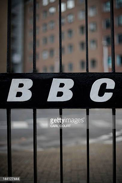 A view of a BBC logo on a gate near the entrance to the BBC Television offices in west London on October 6 2011 The British Broadcasting Corporation...