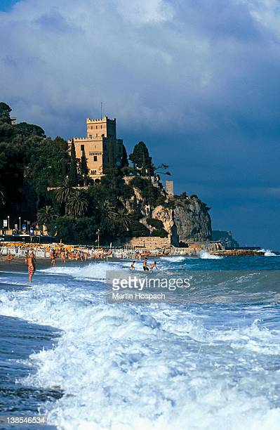 View of a beach and a castle in the background, Liguria, Italy