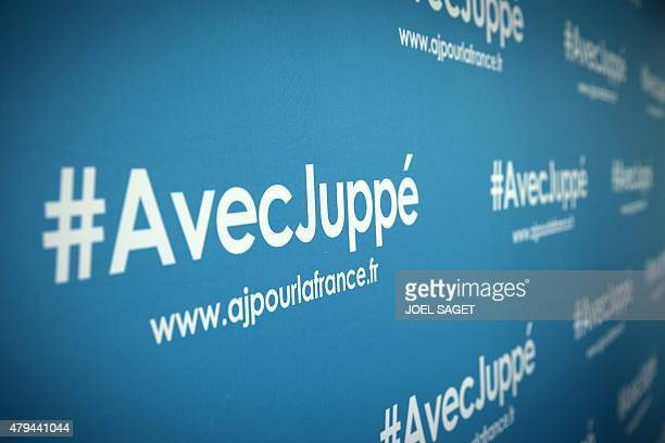 View of a blue screen bearing the hashtag 'AvecJuppé' and the website of rightwing primary elections candidate Alain Juppe during a barbecue...