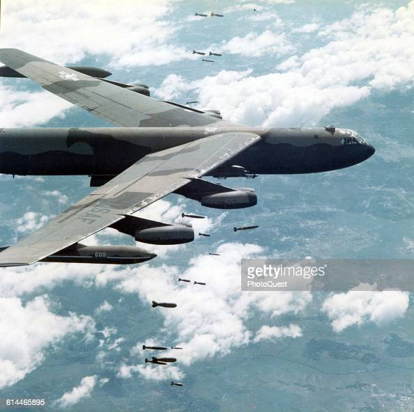 View of a Boeing B52 Stratofortress as it drops its payload of bombs on a target near Bien Hoa Air Base Vietnam December 1 1966