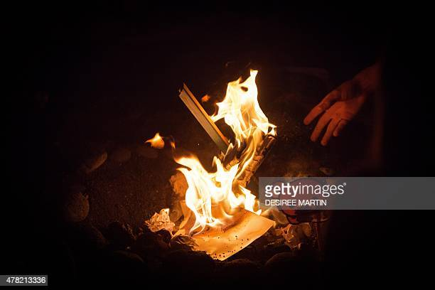 View of a bonfire during the traditional Saint John night which coincides with the summer solstice at the beach of Puerto de La Cruz on the Spanish...