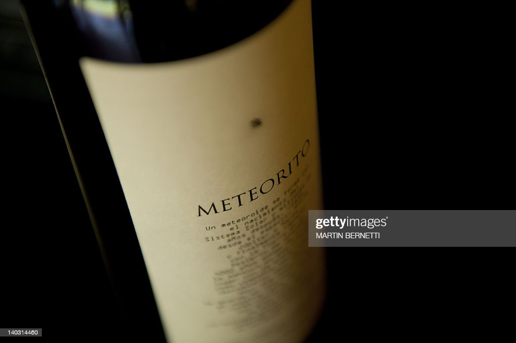 View of a bottle of Meteorito wine at Tremonte vineyard in San Vicente de Tagua Tagua, 120 km south of Santiago, on February 15, 2012. British astronomer and wine producer Ian Hutcheon, owner of the Tremonte vineyard, recently presented Meteorito, a unique drink prepared with a Cabernet Sauvignon wine in which barrel he puts the 4.5 billion-year-old meteorite for a 12-month aging. AFP PHOTO/Martin BERNETTI