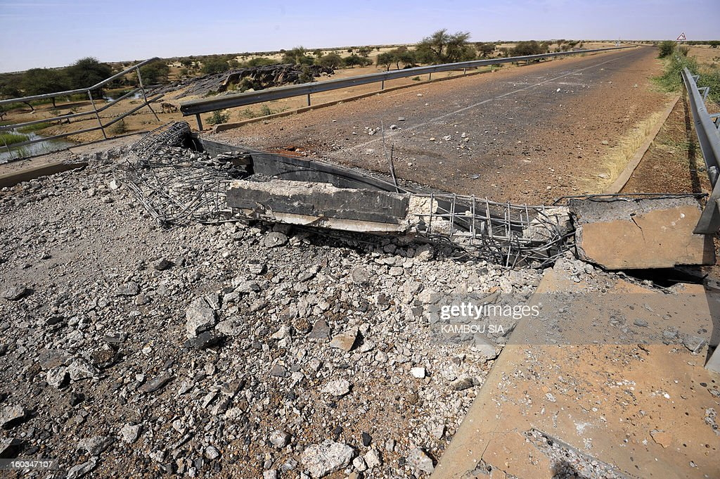 View of a bridge blown up by the Movement for Jihad and Oneness (MUJAO) near Ansongo, a town south of the northern Malian city of Gao on January 29, 2013. Troops from Niger and Mali on January 29 entered Ansongo, which along with Gao was recaptured by French-led soldiers over the weekend in a lightning offensive against radicals holding Mali's north. So far, just 2,000 African troops have been sent to Mali or neighboring Niger, many of them from Chad, to boost the French-led offensive which began on January 11 and led to the recapture of several towns, including Ansongo.