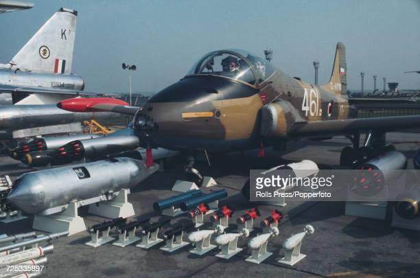 View of a British built BAC 167 Strikemaster light attack jet aircraft on static display with assorted weaponry at Le Bourget Airport during the 1971...