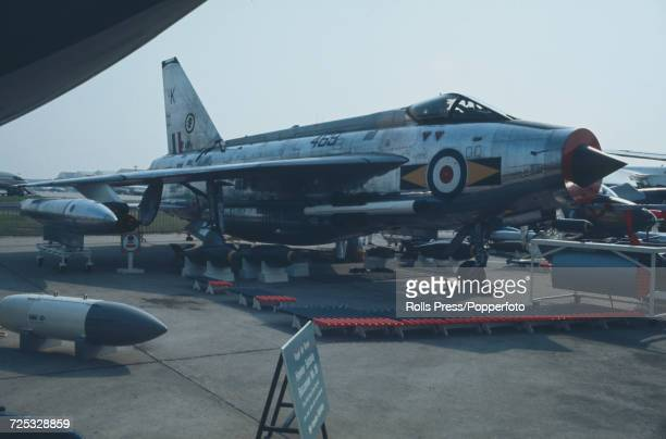 View of a British built English Electric Lightning supersonic fighter aircraft of the British Aircraft Corporation on static display with assorted...