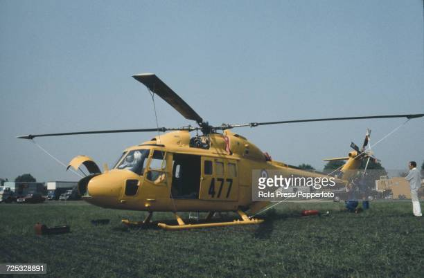 View of a British built Westland Lynx four bladed military helicopter in yellow Royal Navy livery on static display at Le Bourget Airport during the...