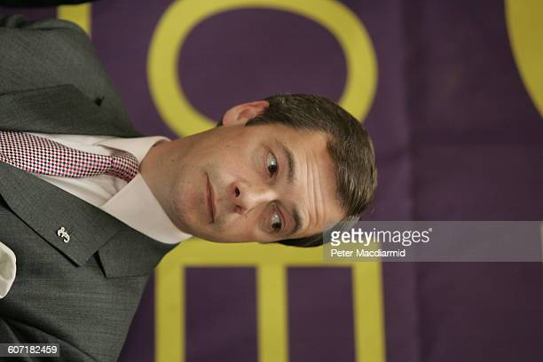 View of a British politician Nigel Farage during a press conference England May 12 2004 The banner behind him reads 'Say No to European Union' one of...