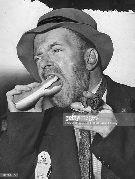 A view of a Brooklyn Dodgers Bum eating a hotdog during the 1949 World Series between the New York Yankees and Brooklyn Dodgers