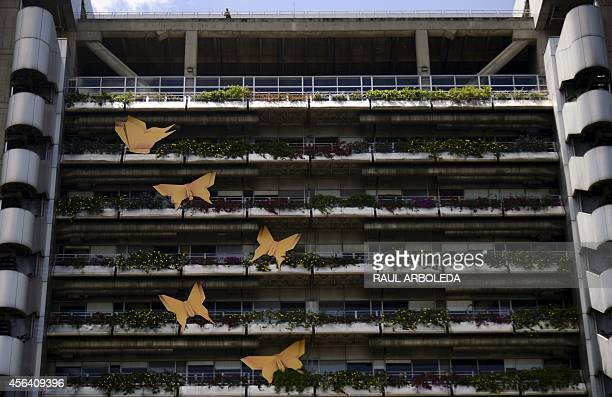 View of a building displaying yellow paper butterflies in honor of the late Nobel Literature Prize laureate Gabriel Garcia Marquez in Medellin...