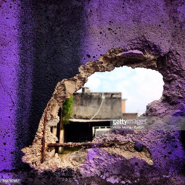 View Of A Building Through Broken Wall Hole