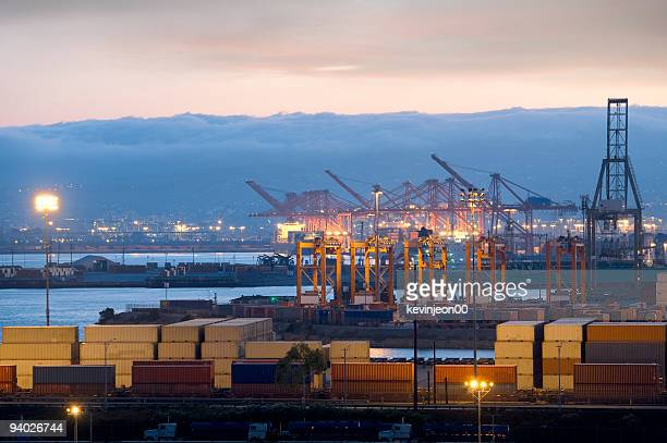 View of a busy harbor with cranes and containers